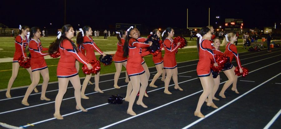 After performing their halftime routine, the girls watched the East High School marching band perform. Once the second half of the game began, the dance team walked off the field and heard the song HandClap. All of the girls began to dance, and danced to the same routine they had just performed only minutes before.