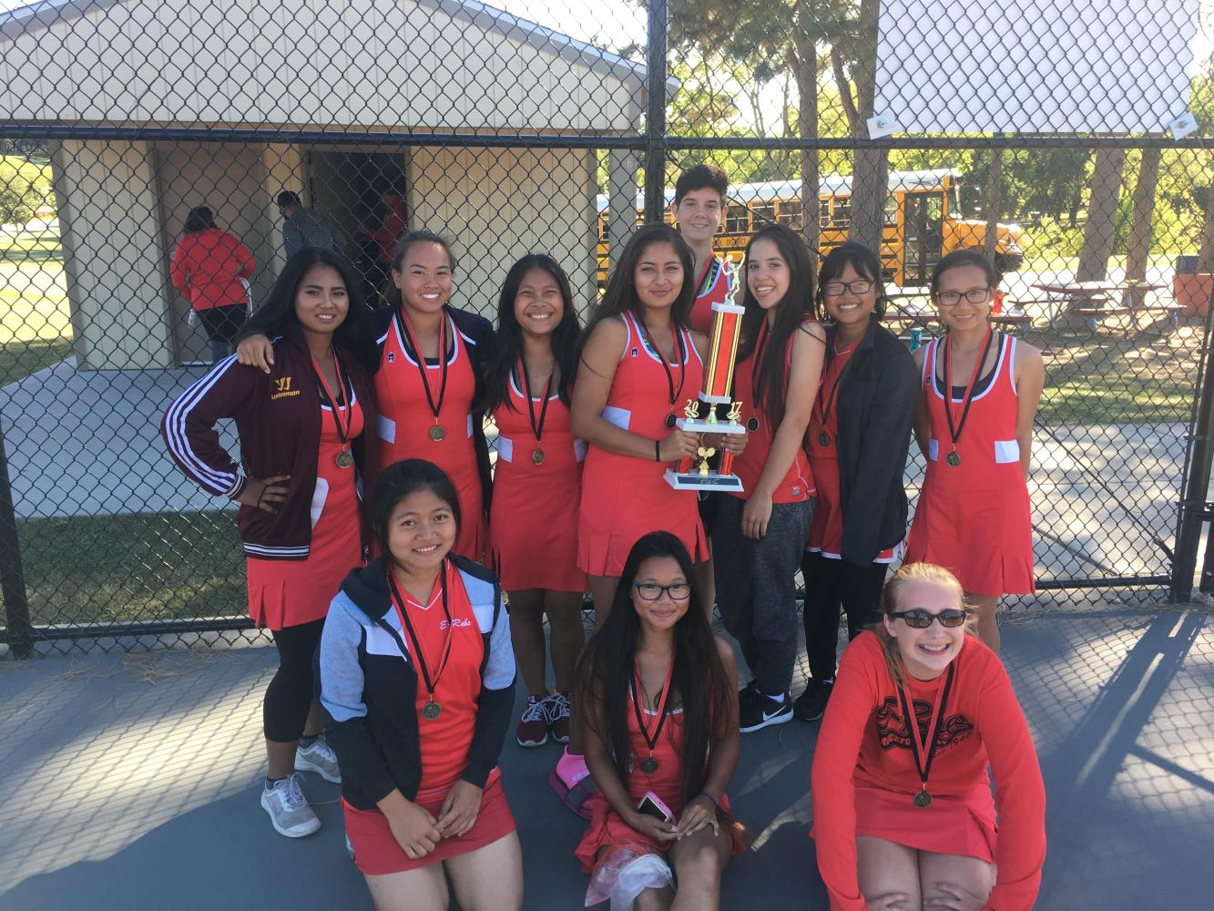 E-Rab ladies take first place at East Aurora tournament on September 30. All girls in the East tennis team took home a first or second place medal.