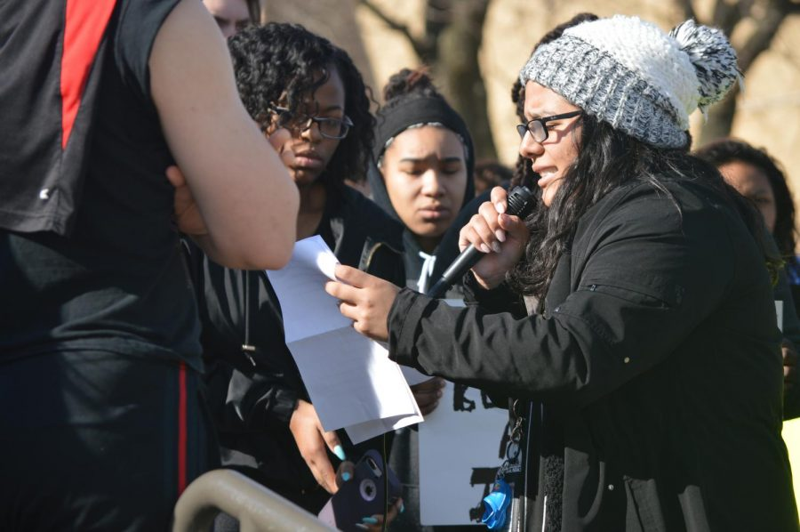 Alondra Lavariega, class of 2018, is emotional as she presents her speech to her fellow students and community members during the walk-out.