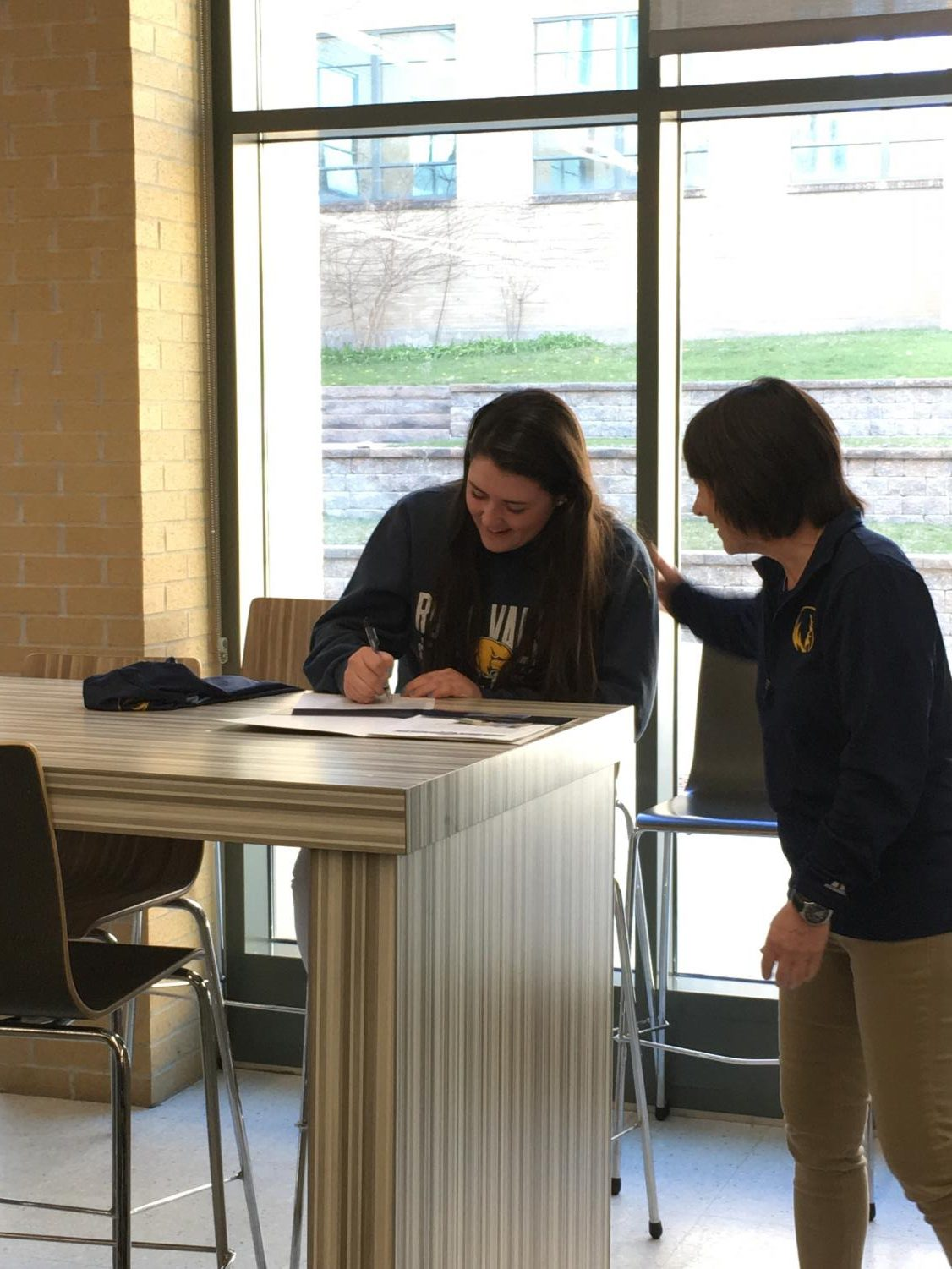 4/18/18 Effie Christidis, class of 2018, signs to Rock Valley College for volleyball.