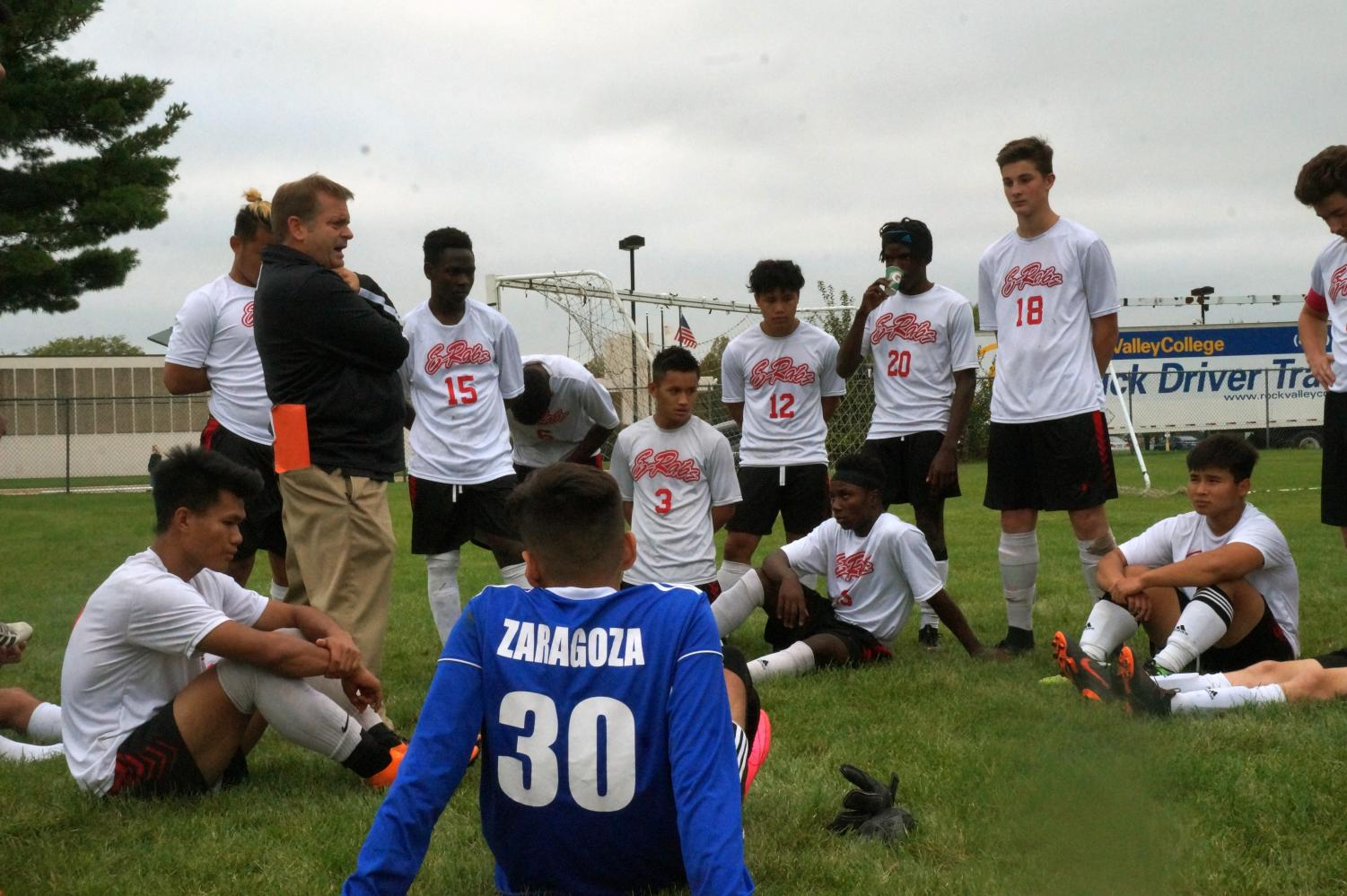 Greg Fiorucci, head soccer coach, talks to the varsity soccer team at half time of their game against Jefferson. The E-Rabs were up 2-0 at half time, and defeated the J-Hawks 5-0.