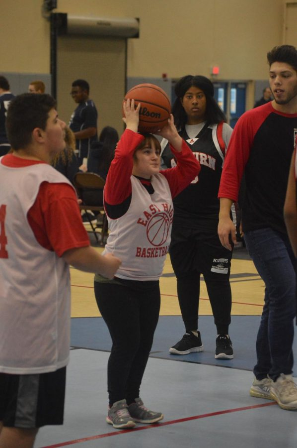 Edith Veitch, class of 2021, prepares to take a shot at the basketball hoop. Veitch competed with Buddies Club in the Special Olympics tournament on Dec 15.
