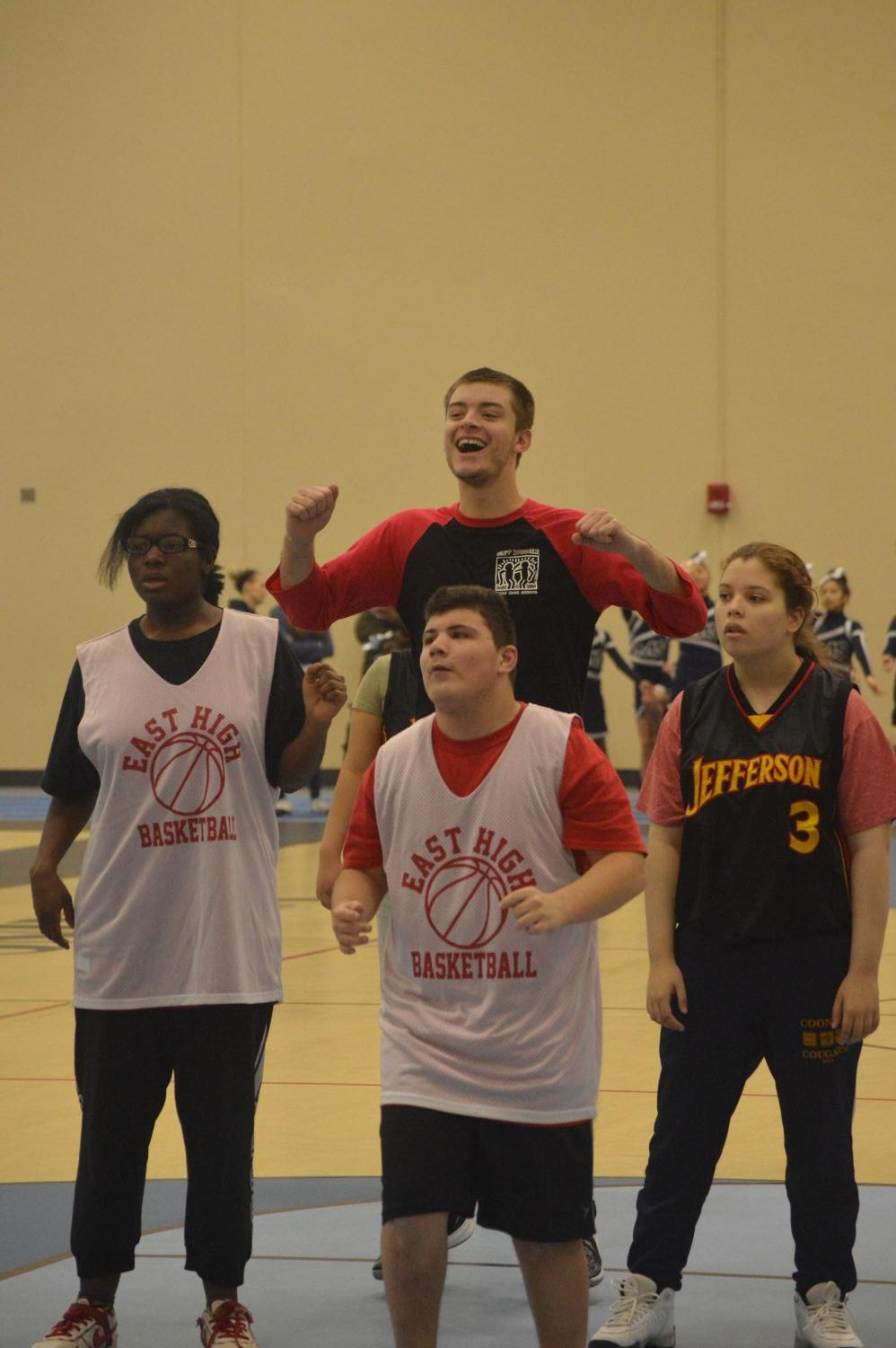 Derek Moore, class of 2019, cheers on the Buddies Club team as they attempt to score a basket. Moore coached the Buddies Club team in preparation for the tournament.