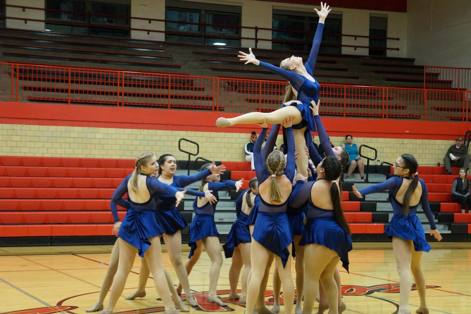 "The East dance team performs their lyrical dance routine. They were the second performance of the night in the NIC-10 dance competition. ""We have definitely overcome our lack of confidence and just overall improved everything from technique to facials everything has gotten better,""said Hailey Hunter, co-captain of the dance team."